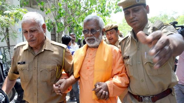 Swami Aseemanand being produced at a court.(HT File Photo)