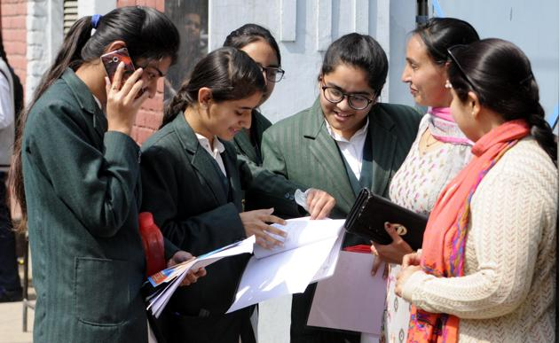 Students meet up with parents after appearing for the CBSE senior school certificate examinations outside the Our Lady of Fatima convent senior secondary school in Patiala on Thursday. (Bharat Bhushan/ HT file photo)