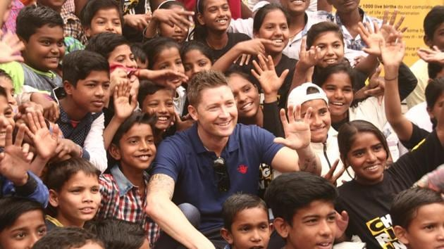 Former Australia captain Michael Clarke spent time with some underprivileged children at a city slum on Friday.(HT Photo)