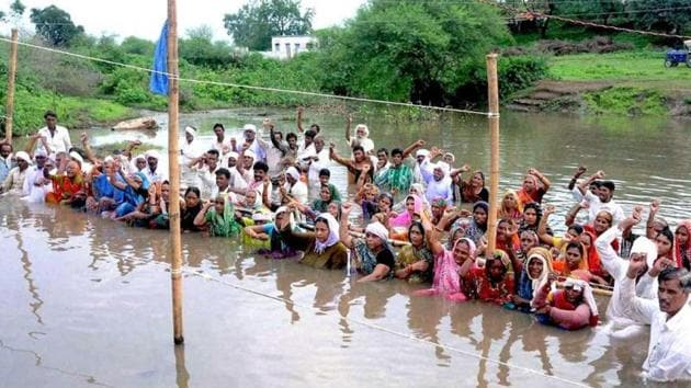 People protest in back waters of Narmada river in Khandwa District, Madhya Pradesh.(AP File Photo)