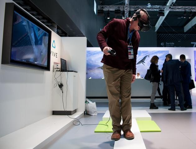 A visitor uses a virtual reality device during the Mobile World Congress on the third day of the MWC in Barcelona, on March 1, 2017.(AFP)