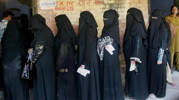 Muslim women line up at a polling booth in Varanasi during the seventh and final phase of the Uttar Pradesh polls on March 8. Despite not having put up a single Muslim candidate, the BJP has now indicated that it would accommodate minority candidates in government.(PTI)