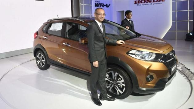Chief Operating Office and CEO Regional Operation (Asia & Oceania) Mr Noriake Abe (L) pose with newly launched ' Honda WR-V' in New Delhi. (Vipin Kumar/HT PHOTO)
