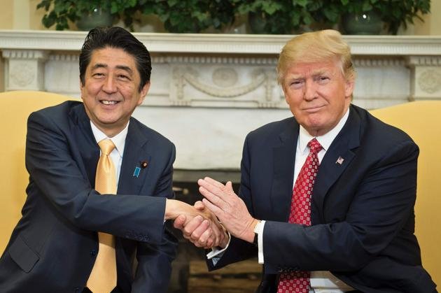 Japan's Prime Minister Shinzo Abe and US President Donald Trump shake hands before a meeting in the Oval Office of the White House on February 10.(AFP)
