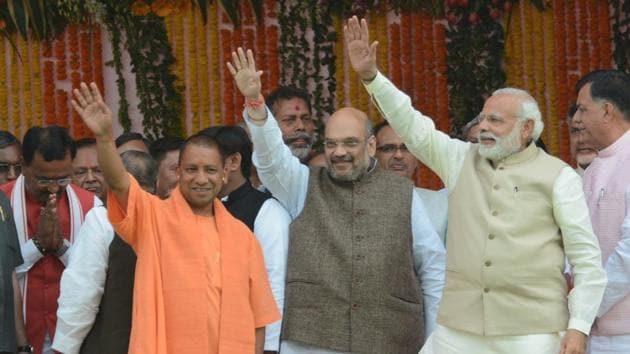 Yogi Adityanath (left), BJP chief Amit Shah (centre) and Prime Minister Narendra Modi at Smriti Upvan in Lucknow on Sunday.(Ashok Dutta/HT Photo)