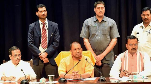 UP Chief Minister Yogi Adityanath with deputy CMs Dinesh Sharma and Keshav Prasad Muriya at a meeting of police officers in Lucknow on Monday, March 20, 2017.(PTI)