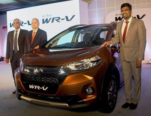 "Sr Vice President and Director, Raman Kumar Sharma (C), Senior Vice President , Sales and marketing, Jnaneshwar Sen (L) and Senthil Kumar Natarajan (R), Zonal Head Sales South, during the Launch of Honda ""WR-V"" car in Bengaluru.(PTI)"