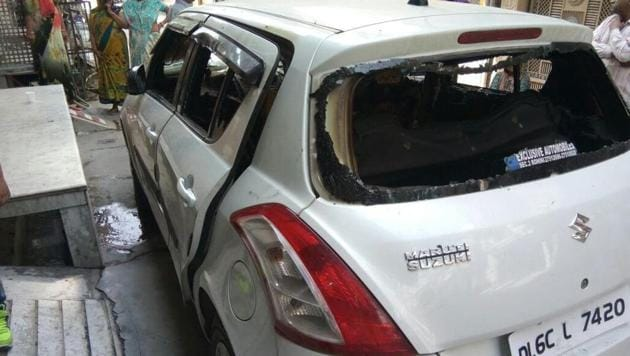 The car that caught fire in Krishna Vihar in Rohini on Thursday afternoon. All the windows, except the one on the driver's seat, were rolled up when it went up in flames.