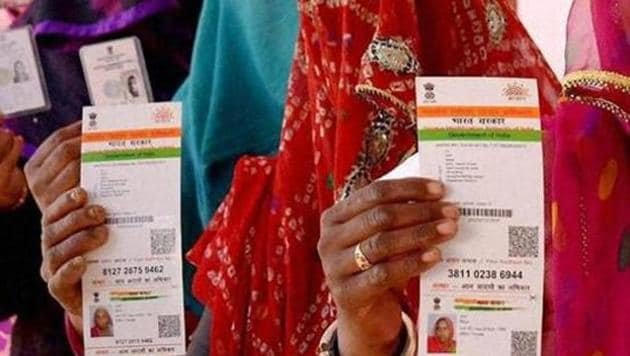 Rajasthani women showing their Aadhaar cards while standing in a queue to vote for a Panchayat election, January, 2016.(PTI File)