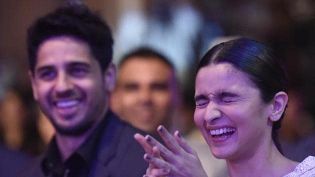 Sidharth Malhotra and Alia Bhatt share a light moment during the HT Most Stylish awards in Mumbai on Friday.(Kunal Patil/HT Photo)