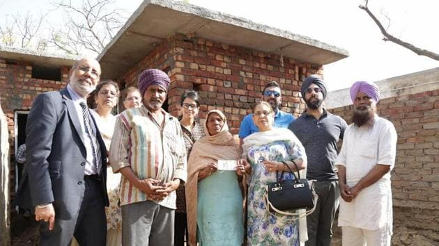 Cancer victim Raj Singh Brayana's family members with beneficiaries in Malerkotla.(HT Photo)