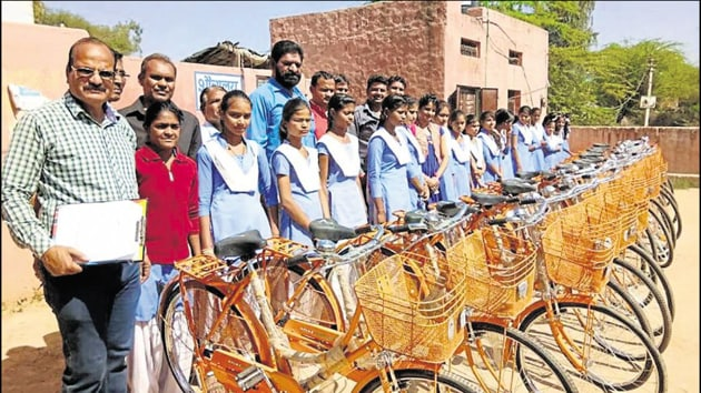 To check the dropout rate, Class 9 students in Rajasthan were gifted orange cycles in February this year. The opposition termed the move as yet another attempt at saffronisation of education in the state.(HT Photo)