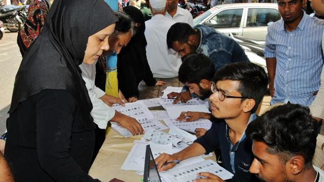 """Voters at a polling booth in Thane , February 21. With the stated intention of improving """"transparency in electoral funding,"""" the government has accomplished precisely the opposite objective(Praful Gangurde/HT Photo)"""