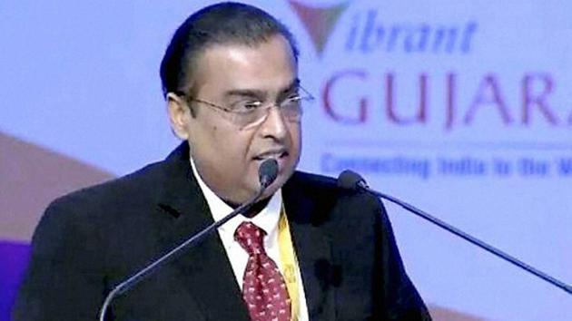 Mukesh Ambani Chairman of the RIL group of Industries addresses the gathering at the 4 days long 8th edition of the vibrant global Gujarat summit.(PTI)