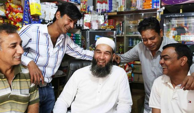 As part of the Sunday ritual, these five friends sit at Arab Sarai General Store in central Delhi's Nizamuddin Basti for two hours — from 1 pm until the afternoon prayers — when they get up to offer namaz at the adjacent Markazi Mosque.(Mayank Austen Soofi)