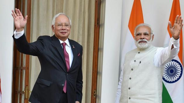 Prime Minister Narendra Modi with his Malaysian counterpart Najib Razak before their meeting at Hyderabad House in New Delhi on Saturday.(PTI Photo)