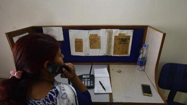 A volunteer at Snehi attends to callers. The organisation has reduced its operation time from eight hours, seven days a week to five hours six days a week.(Vipin Kumar/HT Photo)