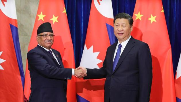 Chinese President Xi Jinping (R) shakes hands with Nepalese Prime Minister Pushpa Kamal Dahal (L) at the Great Hall of the People in Beijing on March 27(AFP)
