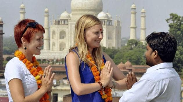 Foreign tourists visiting India on e-visa can now stay up to two months, instead of the earlier one, and enjoy double-entry benefits while those coming for treatment can avail triple-entry facility.(PTI File Photo)