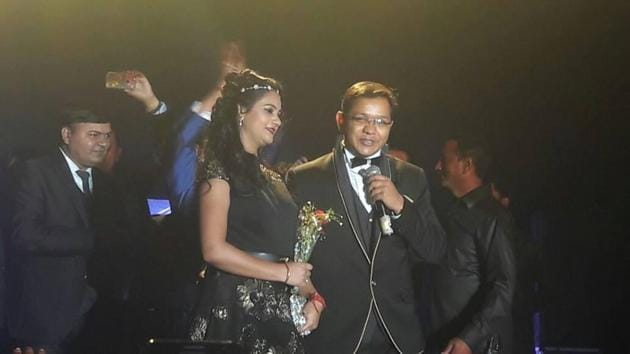 The kingping of Noida ponzi scheme Anubhav Mittal (right) with his wife Ayushi at a party. Mittal's wife and his father have been made accused in the case by UP Police's special task force which is investigating the case.(Handout)