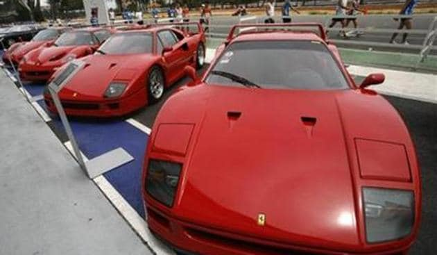 Ferrari cars, including the F40 (R and 2nd R), F50 (2nd L) and Enzo sit on display during a show of luxury cars in Singapore.(Reuters photo)