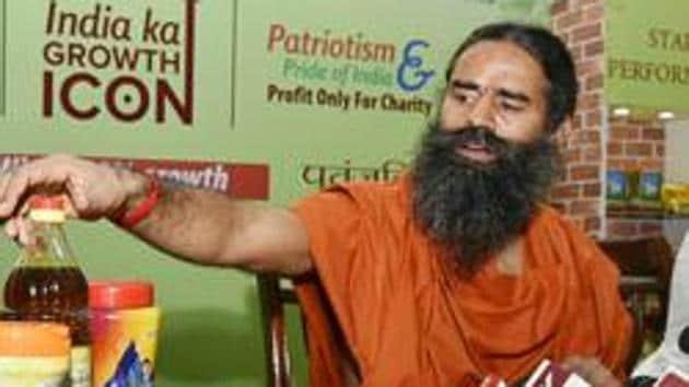 Yoga guru Ramdev displaying Patanjali products in New Delhi.(HT File Photo)