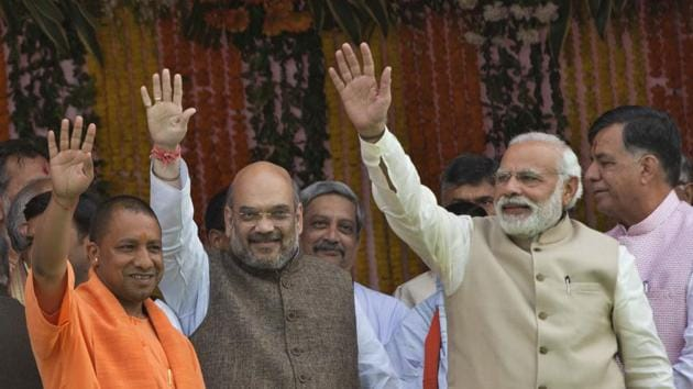 From right, Prime Minister Narendra Modi, Bharatiya Janata Party president Amit Shah and UP chief minister Yogi Adityanath, in Lucknow, March 19. It is shocking to read some people who were regular and prominent faces at 'Liberal' feasts today seeking a chance for Yogi Adityanath on the development plank.(AP)