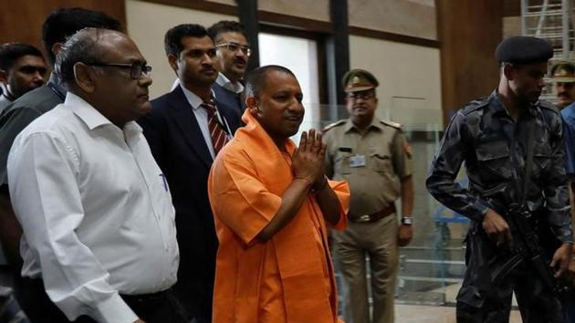 Yogi Adityanath, newly appointed chief minister of Uttar Pradesh, arrives to attend a meeting with government officials at Lok Bhavan in Lucknow on March 20.(Reuters)