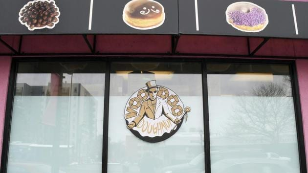 Images of the baked goods available adorn the windows of the storefront of Voodoo Doughnuts on East Colfax Avenue in Denver on Tuesday.(AP Photo)