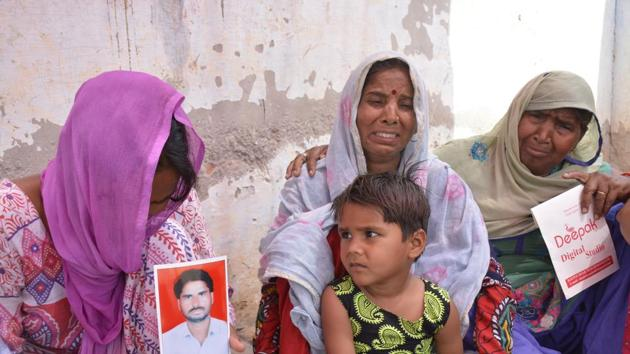Thirty-two-year-old Sujit Singh leaves behind his family of wife, three children and aged parents with no one to fend for them. If GDA demolishes their house, they have nowhere to go.(Sakib Ali/HT Photo)