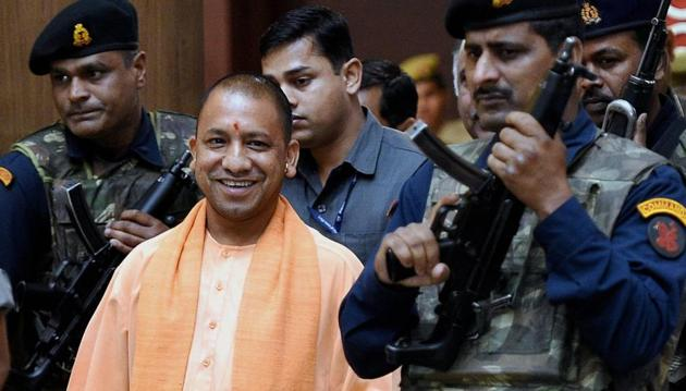 UP chief minister Yogi Adityanath comes out after a cabinet meeting at Lok Bhawan in Lucknow.(PTI)