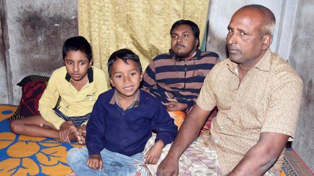 In this photograph taken on January 20, 2017, Bangladeshi father and fruit vendor Tofazzal Hossain (R), who has sparked a debate over assisted suicide, is seen with his two sons and grandson (2nd L) in Meherpur. (AFP Photo)(HT)