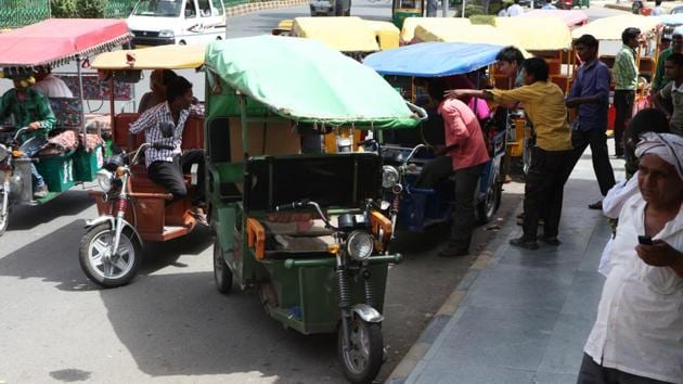 For over one lakh e-rickshaws operating in Delhi, the capital has no legal charging point for the battery-operated three-wheelers, although they are helping in feeding last mile connectivity.(HT File Photo)