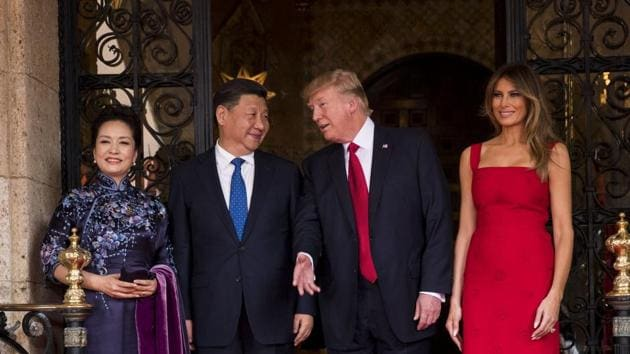 (From right) US first lady Melania Trump, US President Donald Trump greet Chinese President Xi Jinping and his wife Peng Liyuan at the Mar-a-Lago resort in Palm Beach, Florida.(NYT Photo)