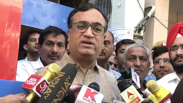 Delhi Pradesh Congress Committee chief, Ajay Maken speaks to media after casting his vote for the Rajouri Garden bypolls.(HT PHOTO)