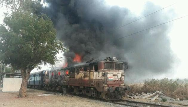 A short circuit is suspected to have started the fire in the engine of the Gomo-Barwadih passenger train in Jharkhand. All passengers and the two drivers escaped unhurt.(HT Photo)