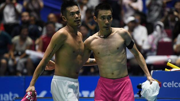 China's Lin Dan exchanges shirts with Lee Chong Wei after vanquishing the Malaysian world No 1 in the final of the Malaysia Open Badminton Superseries in Kuching on Sunday.(AFP)