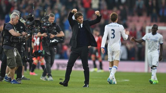 Chelsea's Italian head coach Antonio Conte celebrates at the end of the English Premier League match between Bournemouth and Chelsea at the Vitality Stadium in Bournemouth on Saturday.(AFP)