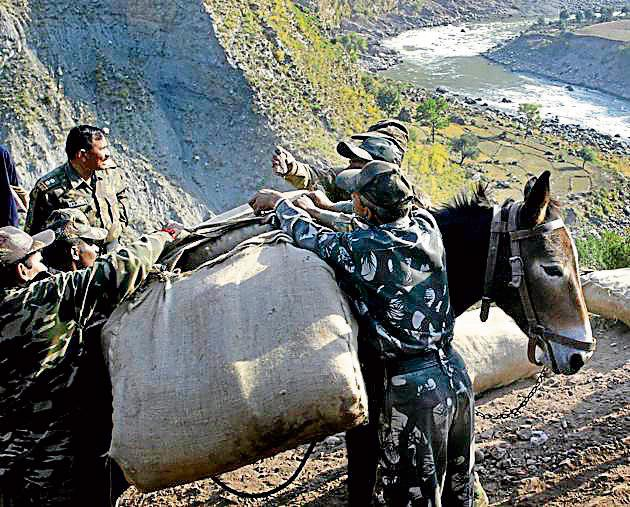 Soldiers load mules with blankets for earthquake survivors in Julla village near the Line of Control in Kashmir in October 2005.(Bloomberg via Getty Images)