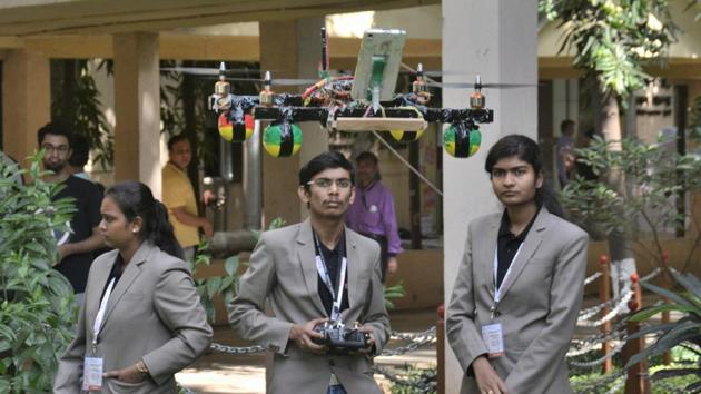 Students from Prof Ram Meghe College of Engineering and Management fly a drone meant to monitor crop health at the e-Yantra Ideas Competition 2017 held in IIT-Bombay on Friday.(Prashant Waydande/HT)