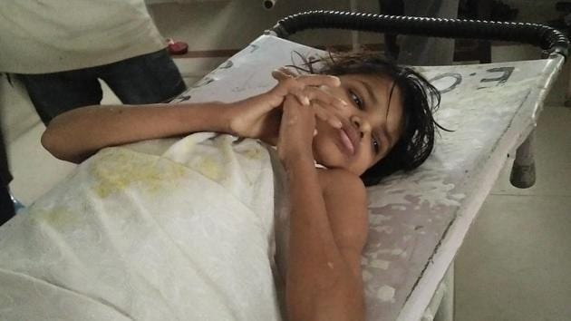 The child, believed to be about 8 years old, was protected by a troop of monkeys as the police had to fend off to bring her to a hospital. Authorities are now looking for her parents.(HT Photo)