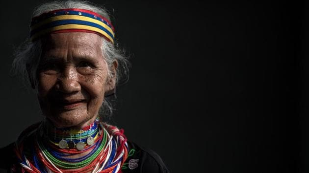 Anyu Daik, 70, from a sub-tribe of the Bidayuhs indigenous group wearing a traditional necklace called 'Tumbih' in Padawan in the state of Sarawak on the island of Borneo. There are currently only five Bidayuh women or 'ring ladies' still alive in Malaysia. The women started wearing the yellow copper rings when they were around 10 and have continuously worn them since as they are seen as a sign of beauty and prestige. According to the Bidayuh community, this is a tradition that has been passed down for generations. It is also believed that their ancestors traded with the Chinese and the copper rings were payment for goods procured from the villagers. (Mohd RASFAN / AFP)