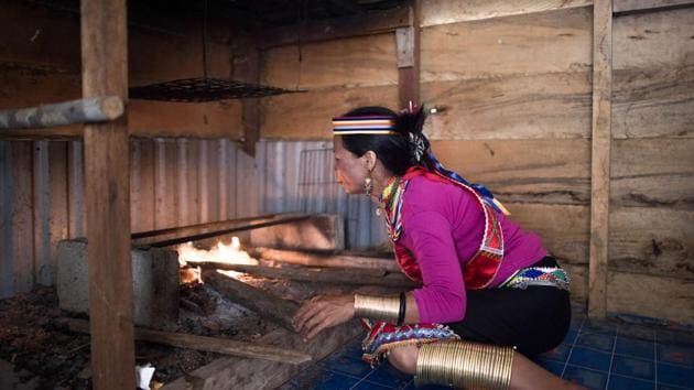 At the age of 40, Anat put on the ruyang for the forearms and rasung for the calves to honour the tradition which embodies the distinctive culture of the Semban, a sub-tribe of the Bidayuh. (Mohd RASFAN/ AFP)