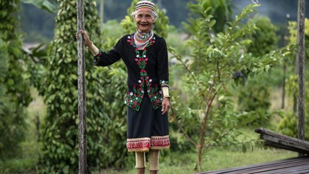 Anyu Daik, 70, smiles as she poses for a picture in Padawan in the state of Sarawak on the island of Borneo. (Mohd RASFAN / AFP)