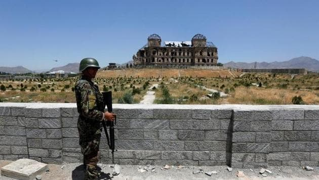 An Afghan National Army (ANA) soldier stands guard after the inauguration of the reconstruction project to restore the ruins of historic Darul Aman palace, in Kabul, Afghanistan.(Reuters Representative Photo)