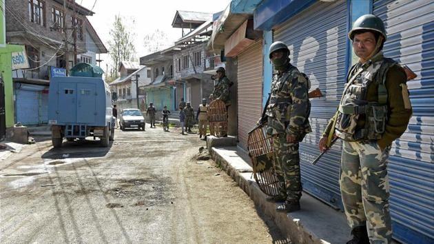 CRPF personnel maintain vigil during repoll in Srinagar Lok Sabha constituency in Budgam district of Kashmir on Thursday.(PTI Photo)