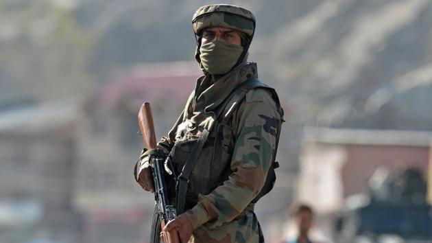 An Indian Army soldier stands guard near the scene of an attack on a Central Reserve Police Force (CRPF) convoy at Panthachowk on the outskirts of Srinagar on April 3.(AFP File Photo)