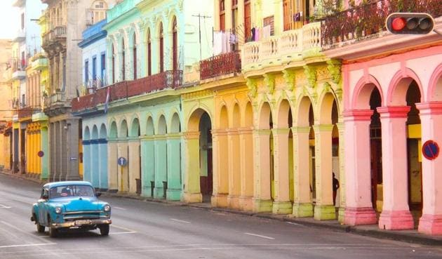 A car on the streets of Havana. Tourists love the island's timelessness, which gives it the aura of a living postcard immune to change.(Shutterstock)