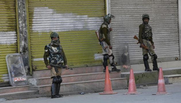 Soldiers stand guard during a strike in Srinagar, Kashmir.(AP File Photo)