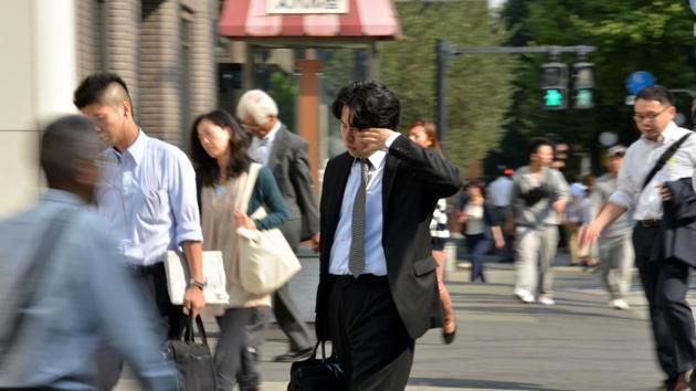 Workaholic Japan has unveiled in March 2017 its first-ever plan to limit overtime.(AFP File Photo)